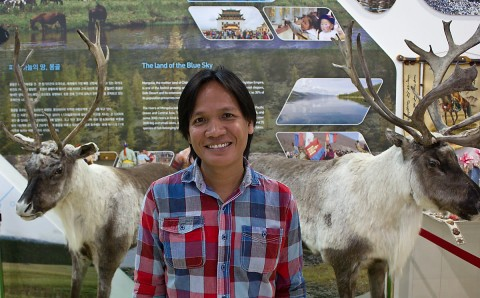 My friend Nai posing with Mongolian reindeer