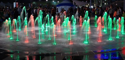 Another colorful fountain at night.