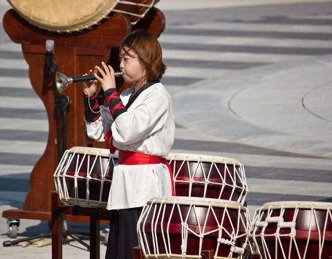 Young lady performing in the Korean percussion group