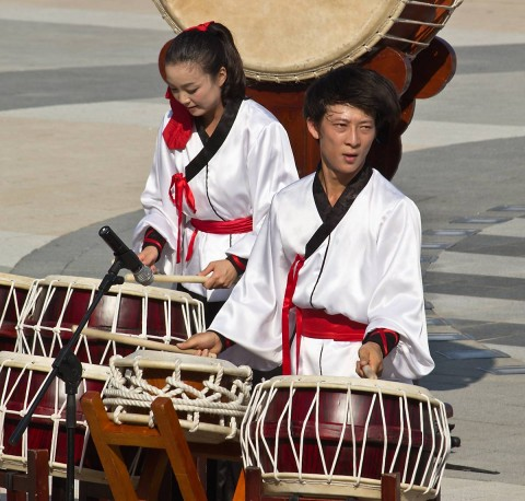 Man and lady playing the drums