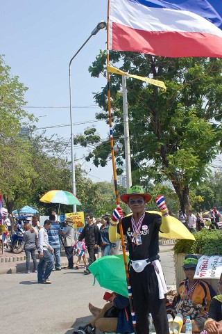 Flag waver at Lumphini Park protest.
