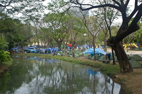 Tents along a stream at Lumphini Park