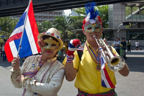 German man and wife at Bangkok protests.