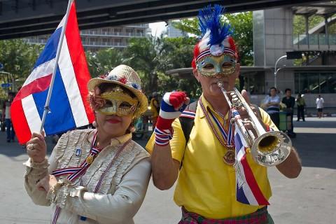 German man and wife at Bangkok protests.