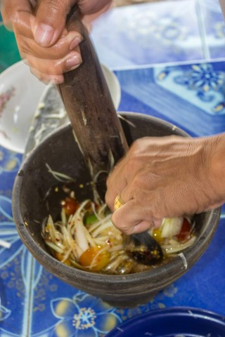 Mixing the papaya salad.
