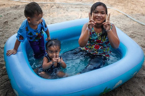 Kids in a wading pool.